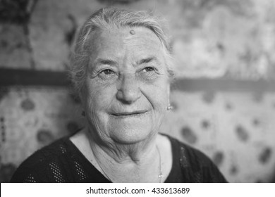Portrait of one beautiful old woman. Magic grandmother. Black and white