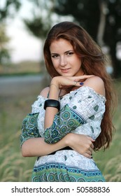 portrait of one beautiful young girl outdoor