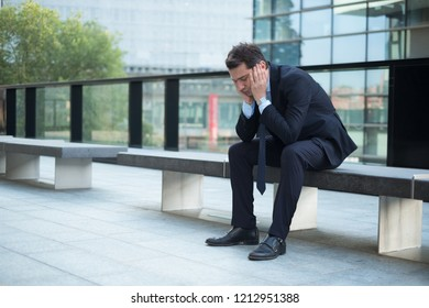 Portrait of one depressed manager in trouble