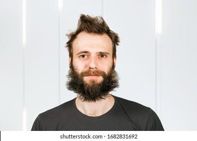 Portrait one freak bearded shaggy man with long hair before haircut in barbershop.