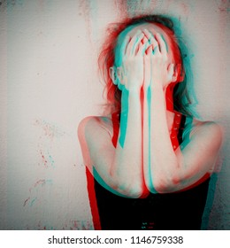 Portrait of a one sad woman standing outdoors near the house at the day time. Concept of sadness. Glitched style photo.