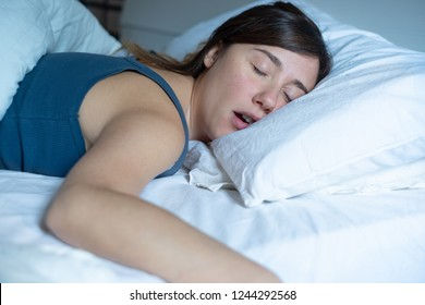 Portrait of one tired woman snoring in bed