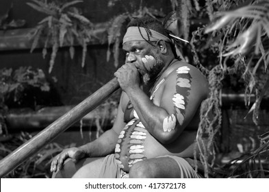 Portrait of one   Yirrganydji Aboriginal man play Aboriginal music on didgeridoo, instrument during Aboriginal culture show in Queensland, Australia.(BW)