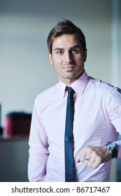portrait of one young business man at bright office indoor