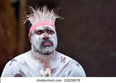 Portrait of one Yugambeh Aboriginal man with body paint during Aboriginal culture show in Queensland, Australia.