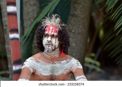 Portrait of one Yugambeh Aboriginal warrior man covered with body painting during Aboriginal culture show in Queensland, Australia.