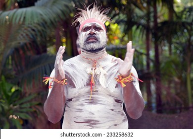 Portrait of one Yugambeh Aboriginal warrior man pray during Aboriginal culture show in Queensland, Australia.