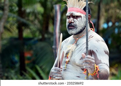 Portrait of one Yugambeh Aboriginal warrior man preform Aboriginal culture martial art during Aboriginal cultural show in Queensland, Australia.
