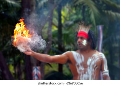 Portrait of one Yugambeh Aboriginal warrior demonstrate  fire making craft during Aboriginal culture show in Queensland, Australia.