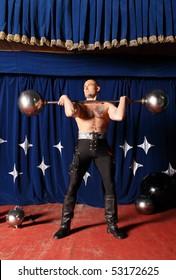 Portrait of one-eyed circus athlete. Photo.