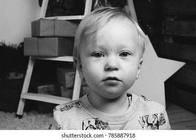 Portrait of a one-year-old child in the interior