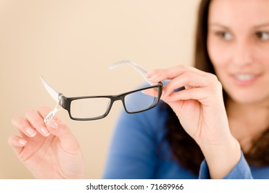 Portrait of optician client choose prescription glasses