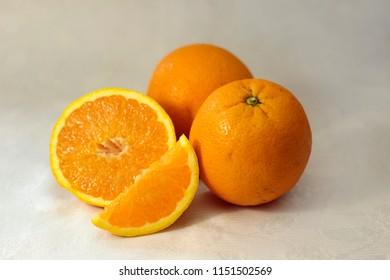 Portrait of oranges (nice composition) on white background. Concept: Fruit, nature, summer, juice