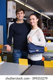 Portrait of ordinary couple at household appliances store