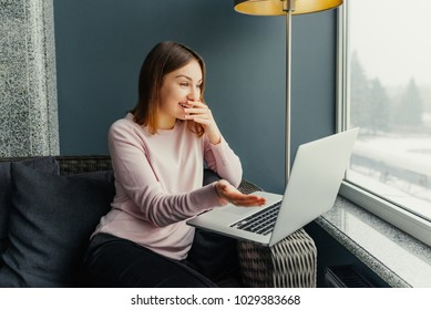 Portrait of overjoyed woman expressing happiness completing project successfully using laptop computer,emotional hipster girl excited with sales in web store making shopping online on netbook