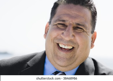 Portrait of an Overweight  Businessman Smiling To Camera