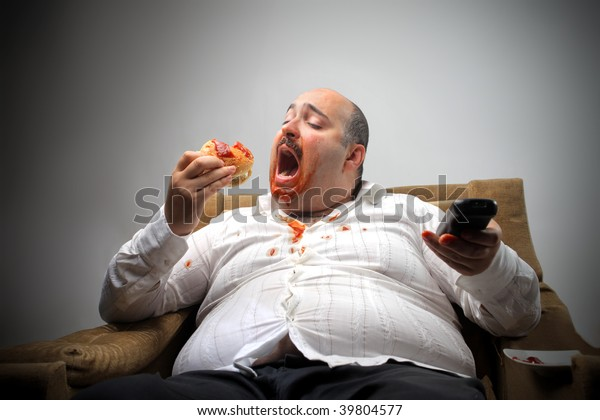 portrait of overweight man eating hamburger