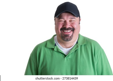 Portrait of Overweight Man Wearing Green Shirt and Black Baseball Cap Laughing in front of White Background, Head and Shoulders Portrait of Joyful Man