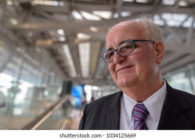 Portrait of overweight senior businessman lounging around the airport