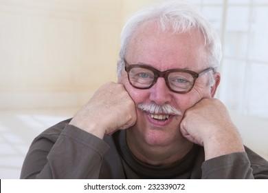 portrait of an overweight senior wearing eye glasses