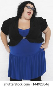 Portrait of an overweight woman winking against white background