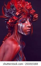Portrait of painted woman in original head wear