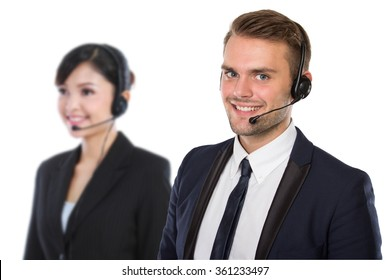 A portrait of a pair of Employee of call center with a headset on