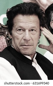 Portrait - Pakistan Tehreek-e-insaf chairman Imran Khan thinking on mic in the youth convention 06/04/2013