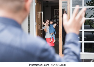 Portrait of parent saying goodbye to their daughter for work