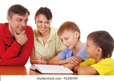 portrait of a parents and sons reading