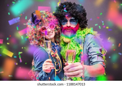 Portrait of party Men and woman in wig and glasses Carneval