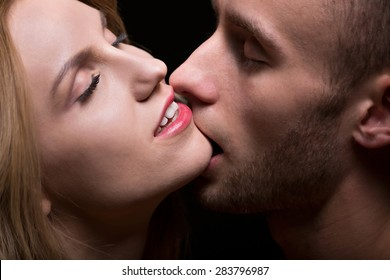 Portrait of passionate man kissing his lover
