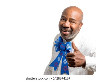 Portrait of a patriotic African American man giving thumbs up with Fourth of July bow tie white backdrop  with blank space for text.