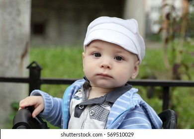 Portrait of pencive toddler on bicycle in a park