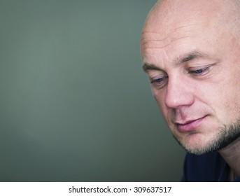 Portrait of a pensive bald man. Toned
