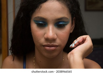 Portrait pensive or concentrated make-up teenage girl