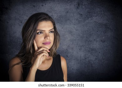 Portrait of a pensive female looking up