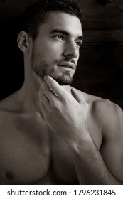 Portrait of pensive handsome man with beard looking away from camera