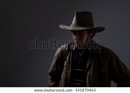 Portrait of a pensive man in a cowboy hat. Copy space for traveler 402d94be1fb