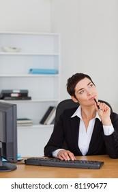 Portrait of a pensive secretary in her office