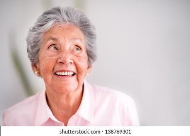 Portrait of a pensive senior woman smiling