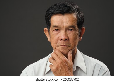 Portrait of pensive Vietnamese senior man