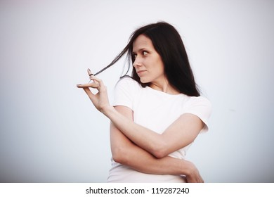portrait of a pensive woman with black hair, brunette
