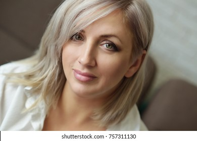 portrait of pensive woman with blonde hair
