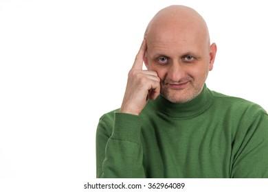 Portrait of a pensive young bald man
