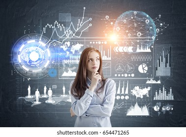 Portrait of a pensive young business analyst standing against a dark background with graphs and infographics. Toned image. Elements of this image furnished by NASA