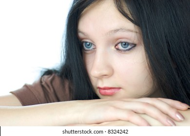 Portrait of pensive young woman with blue eyes looking away isolated on white