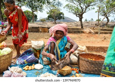 Portrait of people from , Desia Village, Odisha, India, taken in the month of March 2019.  A scene from the local street fish market, women selling local food. dried fish, vegetables and some .