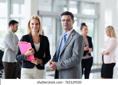 Portrait of people working in car dealership business
