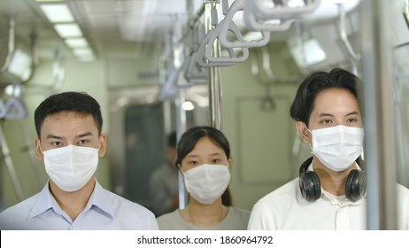 Portrait of peple with mask in train station. New normal lifestyle, Group of young asians of various professions wearing masks protection pollution and pandemic flu virus, keep social distancing.